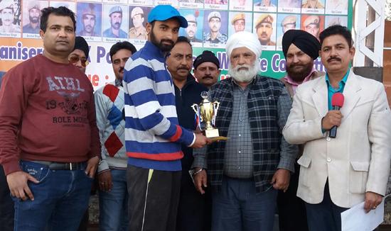 Aman of Khanna CC Jargaon receiving man of the match award at Sports Stadium, Kathua on Monday.