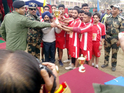 Winners posing alongwith chief guest and other dignitaries during concluding ceremony of Volleyball Tournament.