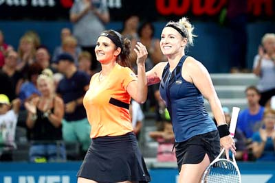 Sania Mirza and Bethanie Mattek-Sands after winning Women's doubles title at Brisbane on Saturday.
