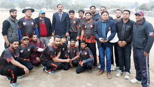 Winners posing for a group photograph alongwith Coordinator of All India Super Six T20 Cricket Tournament for Physically Challenged in Jammu.