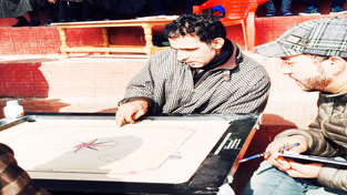 Players in action during Carrom Championship at Shopian.