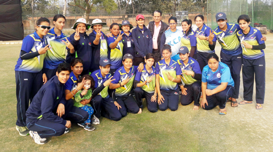 Triumphant J&K Sr Women team showing victory signs while posing for a group photograph after registering win over Chhattisgarh at RCA ground in Jaipur.