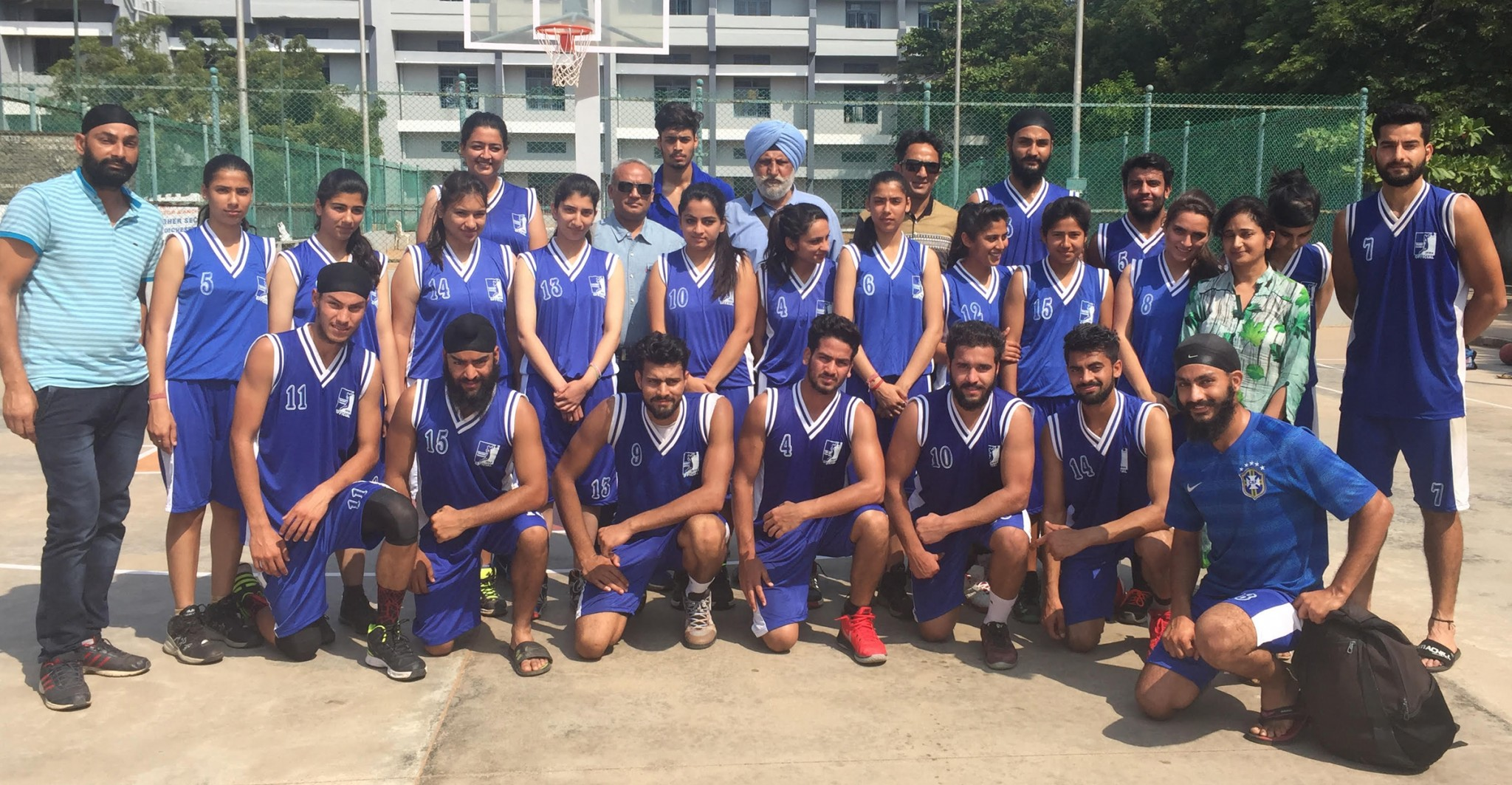 J&K men and women basketball teams posing for a group photograph after registering victories on Wednesday.
