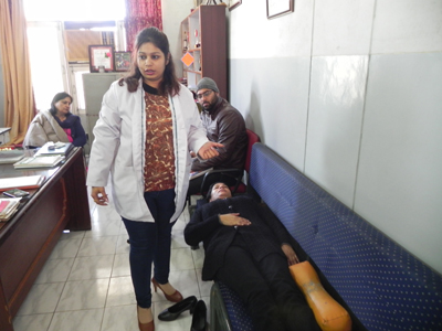 A doctor giving demonstration at Physiotherapy camp at Dogra College of Education in Jammu on Friday.