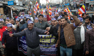SC, ST, OBC employees taking out protest rally in Jammu on Monday. —Excelsior/Rakesh