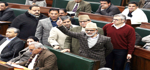 NC MLAs led by Omar Abdullah staging a walk-out in the Assembly on Tuesday. -Excelsior/Rakesh