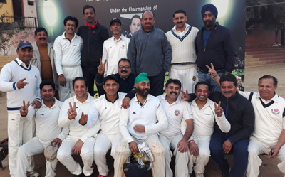 Triumphant star-studded Parade Sports Association team posing for a group photograph after entering into finals of 3rd New Year Masters T20 Cup in Jammu on Friday.