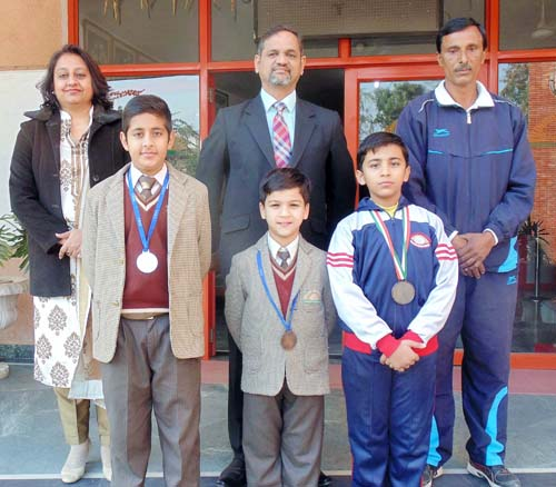 Jodhamal skaters posing alongwith Principal, Trilok Singh Bist and coach, Kamal Anand in Jammu on Thursday.