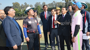 ADGP VK Singh alongwith the skippers and other dignitaries tossing coin while inaugurating Tournament for Physically Challenged Cricketers in Jammu on Friday.