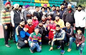 Winners of Baba Fateh Singh Ji Memorial Hockey Tournament posing for a group photograph alongwith chief guest in Jammu on Saturday.