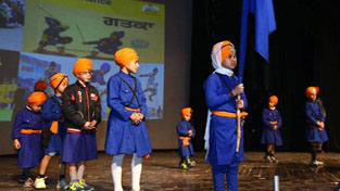 Children presenting colourful item while celebrating Annual Day at Abhinav Theatre in Jammu on Monday.