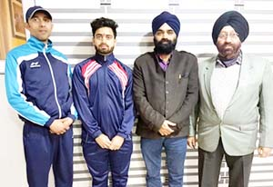 Shubam posing alongwith his coach and office bearers of the Kh-Kho Association in Jammu.