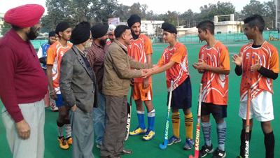 Retired Brigadier RL Sharma interacting with hockey players in Jammu on Friday.