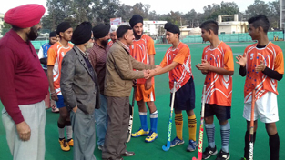Retired Brigadier RL Sharma interacting with hockey players in Jammu on Friday.