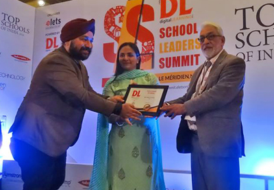 Dr. Ram Thakur, Academic Director KC Public School receiving award on behalf of the institution at New Delhi.