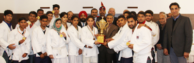 Specially abled sportspersons posing for a group photograph alongwith DGP, Dr SP Vaid during felicitation function in Jammu.
