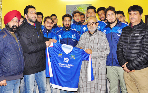 Minister for Education, Naeem Akhtar unveiling uniform of Lone Star Club after his meeting with the contingent in Jammu.