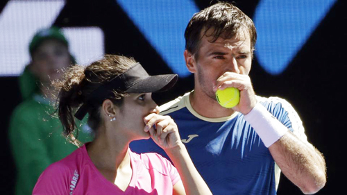 Sania Mirza, left, and partner Ivan Dodig of Croatia chat during their mixed doubles semifinal against Australians Samantha Stosur and Sam Groth at the Australian Open Tennis Championships in Melbourne on Friday.