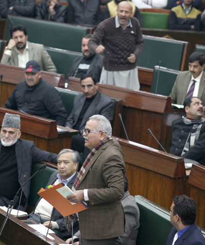 PHE Minister Sham Choudhary and Independent MLA Engineer Rashid exchanging words in the Assembly on Tuesday. -Excelsior/ Rakesh
