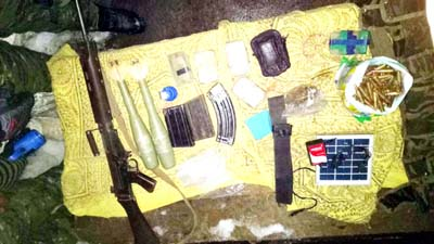 Arms and ammunition recovered from militant hideout busted by security forces at Tranz in Shopian district. -Excelsior/Younis Khaliq