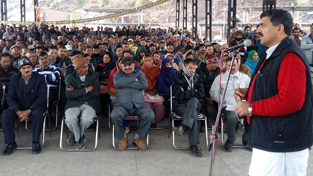MP Jugal Kishore Sharma addressing a gathering of PoJK refugees at Muradhpur in Rajouri on Sunday.