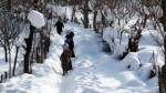 Shopian women passing through snow covered area to fetch water.