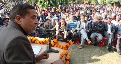 Senior PCC leader Sham Lal addressing workers' meeting at Akhnoor on Sunday.