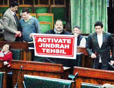 National Conference MLA Devender Singh Rana displaying banner in Legislative Assembly on Tuesday. -Excelsior/ Rakesh