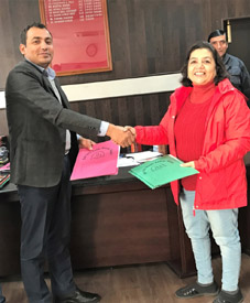 Deputy Commissioner Reasi Ravinder Kumar and Savita Jhingan, Head of Operations MH One TV during exchange of agreement on Tuesday.