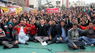 Govt employees and temporary workers staging protest dharna at Divisional Commissioner's office in Jammu on Tuesday. —Excelsior/Rakesh