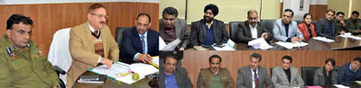 Divisional Commissioner Dr Pawan Kotwal chairing a meeting at Jammu on Monday.