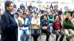 Cong leader Raman Bhalla addressing workers' meeting at Bhour Camp in Gandhi Nagar constituency on Sunday.