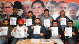 PYC chief Pranav Shagotra and others displaying questions of Rahul Gandhi to PM during press conference in Jammu.