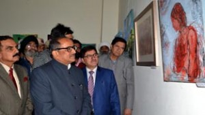 Deputy Chief Minister Dr Nirmal Singh during art exhibition at Jammu on Tuesday.