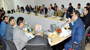 Minister for Food, Civil Supplies and Consumer Affairs Choudhary Zulfkar Ali chairing a meeting at Jammu on Monday.