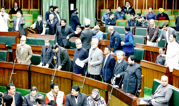Opposition MLAs protesting in the Assembly on post-snowfall problems on Friday. -Excelsior/Rakesh