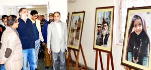 Minister for Finance and Culture Dr Haseeb Drabu looking at the paintings during his visit to Kala Kendra on Sunday.