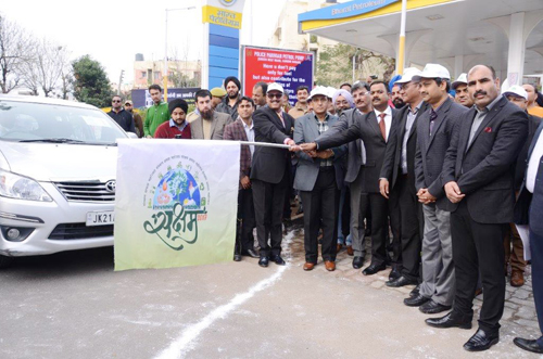 Additional DG of Police, V K Singh accompanied by others, flagging off a fleet of vehicles during a 'Fuel Efficient Driving Contest at Jammu.'