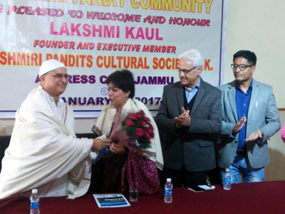 Founder of KPCS London, Lakshmi Kaul being honoured by Kashmiri Pandit leaders in Jammu on Monday.