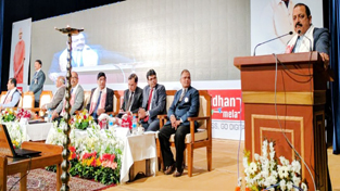 "Union Minister Dr Jitendra Singh addressing the ""Digi-Dhan Mela"" function, at Guwahati on Wednesday."