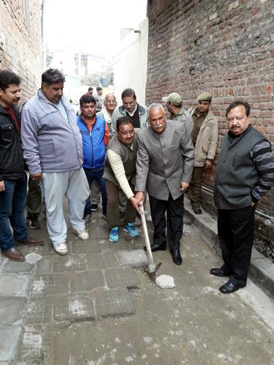 MP Rajya Sabha, Shamsher Singh Manhas kick starting development work of a lane at Ward No 60 in Jammu.