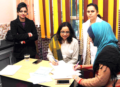 A woman filling up registration form at Janam Fertility Centre of Maxx Lyfe Hospital in Jammu on Saturday.