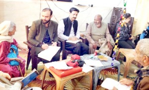 Dr Sushil examines elderly people at Ambphalla Home