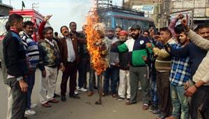 Activists of Shiv Shakti Sena torching effigy of NC MLC at Janipur on Thursday.