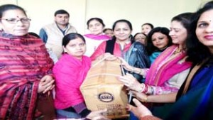 Bollywood actress Preeti Saproo presenting a sewing machine to a needy woman.