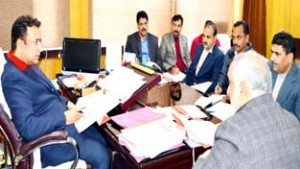 Minister for Food, Civil Supplies and Consumer Affairs Choudhary Zulfkar Ali chairing a meeting at Jammu on Tuesday.