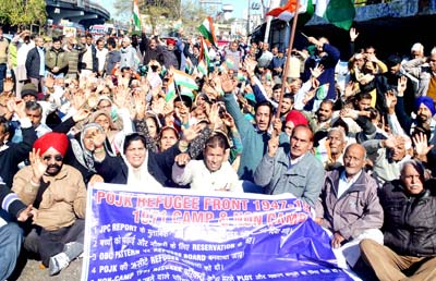 Displaced persons from PoJK raising slogans during protest at Jammu on Friday. -Excelsior/Rakesh