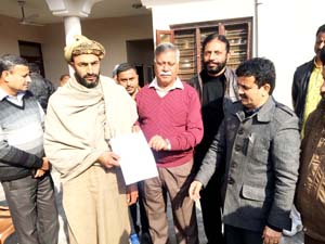 MLA Marh Ch. Sukhnandan distributing relief cheques among firing victims in Gajansoo on Friday.