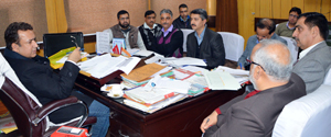 Minister for Food, Civil Supplies and Consumer Affairs Ch Zulfkar chairing a meeting at Jammu on Monday.