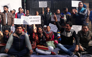 Contractual Lecturers protesting outside the residence of Education Minister Naeem Akhtar at Jammu on Monday.